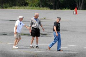 Bruce-Menkowitz,-Art-McKinney,-Don-Roberts-walking-the-course-66